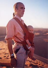 Attachment parenting principles and benefits - carrying - Andrew Green with Fingal on the Saharan dunes in Morocco